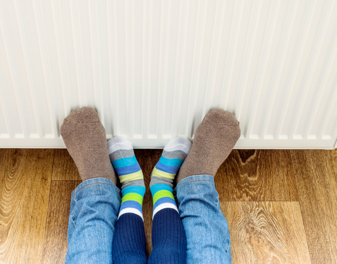 heating feet by the boiler radiator