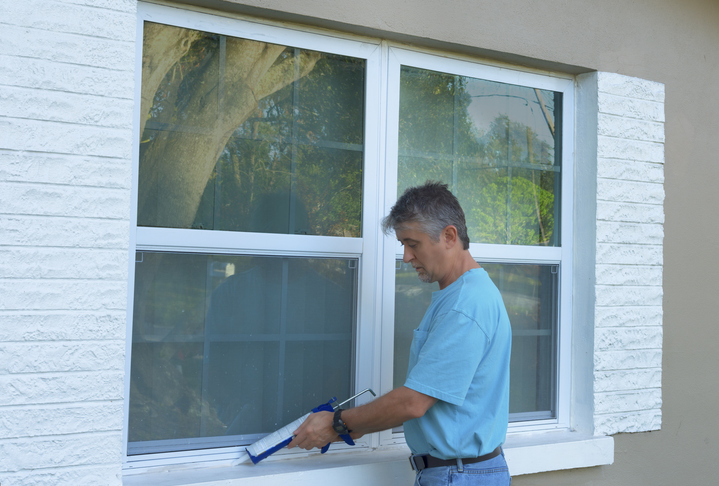 homeowner weatherproofing window